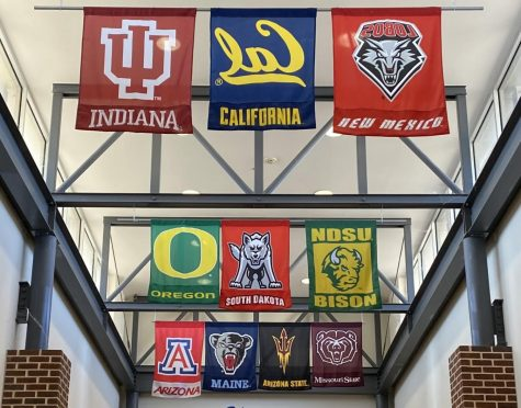 WHS college flags in foyer.
